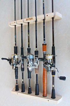 Fishing Rods - www.pinterest.com/1895gunner/ | Handmade Fishing rod racks, wall type of 6 vertical channels.