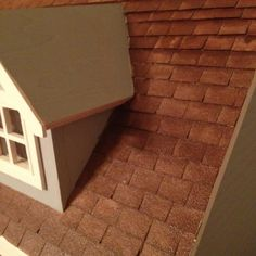 Dollhouse roof shingles made from sandpaper.