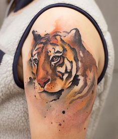 watercolor tiger tattoo idea on arm by @chenjie.newtattoo