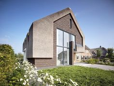 Buildings That Know How To Make A Thatched Roof Look Modern Residential villa with thatched roof design Roof Design, House Design, Box Architecture, Fibreglass Roof, Modern Home Interior Design, Natural Homes, Roof Window, Thatched Roof, Modern Barn