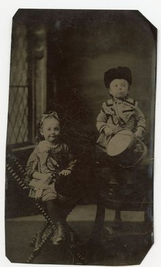"""Little Girl with Doll, Boy with Vintage Toy Drum, Antique Tintype Photo    eBay 1860-1869 ~~"""" A tintype, also known as a melainotype or ferrotype, is a photograph made by creating a direct positive on a thin sheet of metal coated with a dark lacquer or enamel and used as the support for the photographic emulsion. Tintypes were popular during the 1860s and 1870s.')"""