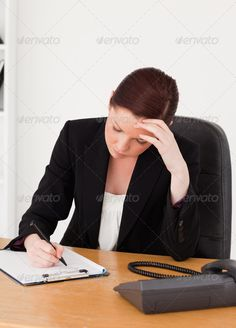 Depressed beautiful red-haired woman in suit writing on a notepa ...  adult, attractive, beautiful, beauty, business, businesswoman, career, caucasian, cheerful, confident, corporate, cute, desk, document, employment, executive, female, girl, hand, happy, human, indoor, isolated, job, looking, notebook, notepad, office, person, phone, photo, portrait, pretty, professional, room, secretary, smile, suit, telephone, white, woman, work, worker, workplace, writing, young