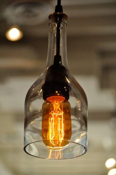 Best creative diy hanging light fixture ideas for your home 06 Wine Bottle Crafts, Bottle Art, Wine Bottles, Beer Bottle, Diy Hanging, Hanging Lights, Solar Lights, Plastik Recycling, Recycled Glass Bottles