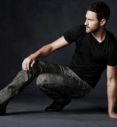 Noah Mills wears jeans & sweaters for Neiman Marcus