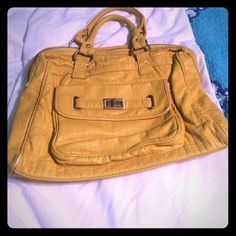 Yellow bag from boutique Yellow bag from boutique. So cute! Missing one zipper string. Easily put on another. Lots of zippers and pockets. I would love to bundle! :) Boutique Bags Totes