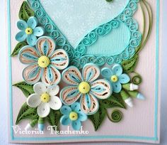 Quilling valentine's day card in blue colors