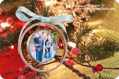 bangle style holiday photo ornaments... wooden circle (photo on one side, highlights from the year, etc on the other), drill a hole through... bangle on the outside--- tied up with ribbon.    would be cool to look back through year after year putting up ornaments