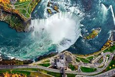 Aerial View of Niagara Falls. Niagara Falls is the collective name for three waterfalls that straddle the international border between the Canadian province of Ontario and the U. state of New York. The falls are at the southern end of the Niagara Gorge. Niagara Falls, Places To Travel, Places To See, Les Cascades, Famous Places, Famous Landmarks, Birds Eye View, Aerial Photography, Amazing Photography