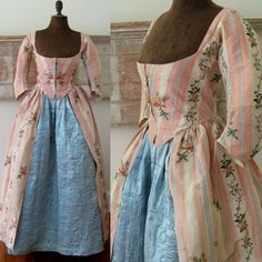 Robe a l'anglaise and petticoat, c.1780. Pink and white striped silk brocaded with floral sprays, sprigs and trailing garlands of flowers; petticoat, blue silk satin, hand quilted in a pattern of vining flowers and foliage that is denser at the bottom, sparser toward the top. It has a glazed wool lining, white cotton waistband with hook and eye closure.