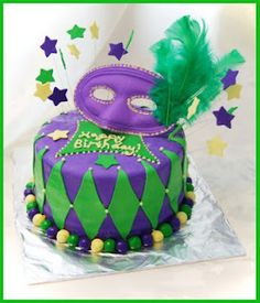 Possibility for Keaton's Mardi Gras themed birthday party (minus the feathers:-)
