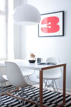 "Dining Table. Clean, white, wood tones - warm & modern.  A ""Charmingly Off-Level"" Oslo Apartment 