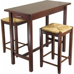 If your kitchen wasn't built with a butcher's block....plop one down anywhere you like! Winsome Kitchen Island Table with 2 Stools