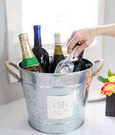 This personalized wine bucket or ice bucket is a perfect wedding,  anniversary or housewarming gift that can be enjoyed for years to come.  It has rope wrapped metal handles and comes with a dual function ice  scoop featuring a bottle opener at the end of the handle. #weddinggift #giftforcouple #engagementgift #weddingidea  #showergift #weddingshowergift #bridalshowergift #beveragetub #icebucket  #personalizedgift #couplesgift #housewarminggift