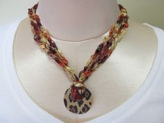 Crochet ribbon ladder yarn necklace with leapord by rlittleton, $10.00
