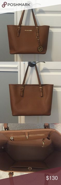 Michael Kors Jet Set Leather Small Travel Tote Michael Kors Jet Set Saffiano Leather Small Travel Tote - I bought it last March 2015, used it for about a year until I got a new one. Still in great condition! 11 inches length X 8.5 inches height X 5 depth inches Michael Kors Bags Totes