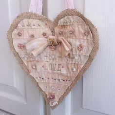 This heart is made of burlap and vintage fabric scraps and lots of vintage buttons!  Inspiration.