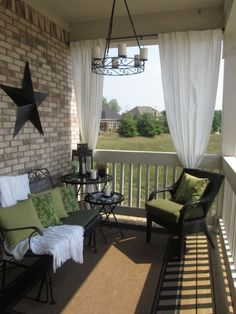 front porch with curtains