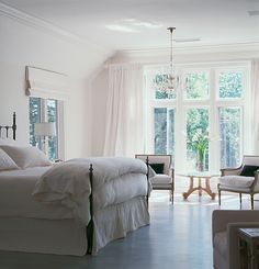 love all the natural light and the chandelier,flooring and whites. dreamy