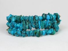 * * Coiled memory wire bracelet with genuine turquoise pebbles  * Turquoise beads are in the 5-9mm range * Memory wire has a 2 1/4 diameter with 3 rows - 3 line  *  This is a memory wire bracelet with