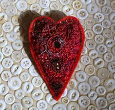 heart brooch, red embroidered with beads and shisha mirror. £7.50