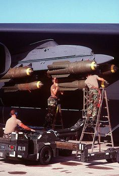 Air Force ordnancemen use an bomb loader to load Mark 117 bombs on a U. Air Force Stratofortress bomber aircraft during Operation Desert Shield. Military Jets, Military Weapons, Military Aircraft, Operation Desert Shield, B 52 Stratofortress, Bomber Plane, Close Air Support, Military Pictures, Home Defense