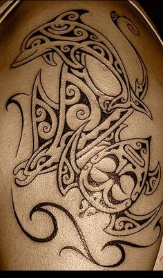 Tattoos Polynesian for Men on Arm & Shoulder representing three of the most known models from the Ancient Traditional Marquesas Tattoo as a Turtle, a Ray Manta and a Dolphin