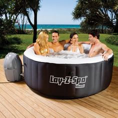 Bestway Lay-Z-Spa Miami Hot Tub -  4 Adult Capacity, Inflatable with Reinforced Cover, Control Panel with LED Display, Easy Setup, Digitally Controlled Pump, Lay-Z Massage System - Black/White
