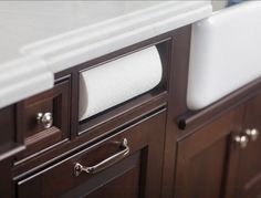Kitchen Ideas. To keep counter clutter to a minimum, a custom paper towel holder is built into this cherry island. #KitchenIdeas