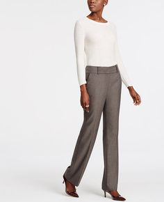 """In a mini herringbone weave, this trouser leg pair is the picture of modern pattern play. Our signature fit, relaxed through your hips and thighs. Contoured curtain waistband offers extra tailoring detail for a better fit. Front zip with double hook-and-bar closure. Belt loops. Front off-seam pockets. Back besom pockets. 33"""" inseam."""