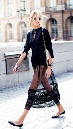 Anja Rubik in a sheer black lace Valentino dress