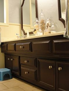 Small and Simple Things: A Bathroom Transformation-  Spray Paint cabinets