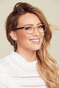 Mood: Driven, grateful, inspiring – The Muse x Hilary Duff Helen is a refined cat eye frame with a powerful side. Featuring a lightweight metal front and acetate arms, it delivers an effortless mix of form and function. Pink Glasses Frames, Womens Glasses Frames, Cute Glasses, New Glasses, Girls With Glasses, Glasses Online, Cat Eye Glasses, Stylish Glasses For Women, Ladies Glasses