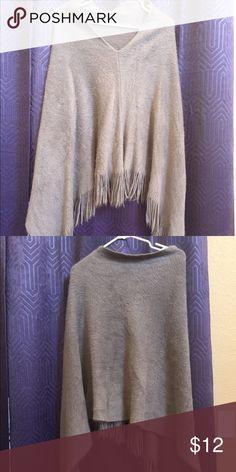 Poncho shawl Light poncho. Looks more like a shawl then a poncho. Brand new, never worn. Sweaters Shrugs & Ponchos