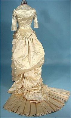 Late 1870s/early 1880s Fan Trained Wedding Gown of Cream Silk Satin with Crystal Beading.