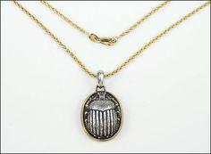 A DAVID YURMAN 22 KARAT YELLOW GOLD AND STERLING SILVER SCARB PENDANT. Lot 150-7300 #jewelry