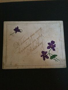 Lovely vintage Christmas card that has embossed pretty violets with colouring that has stood the test of time