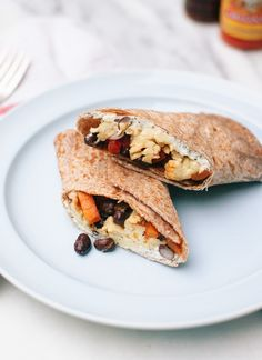 Healthy freezer breakfast burritos with sweet potato hash, black beans and scrambled eggs! cookieandkate.com