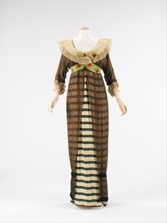 <p>A rare example of Paul Poiret's early revolutionary designs loosely based on the upright, columnar, high-waisted styles worn in ancient Greece, this gown is an innovative melding of the avant-garde and the traditional