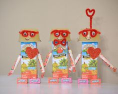 Valentines Day treats for Kindergarten Class. Robots made from apple sauce, juice boxes, and candy! Boy robots with glasses. DIY valentines