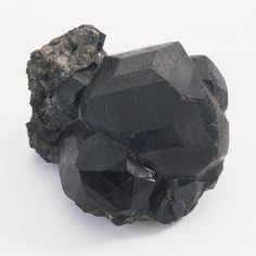 How To Grow Black Crystals: Black crystals occur in nature, such as this specimen of melanite.  What you'lll need: Borax hot water wide mouth jar or glass black pipecleaners black food coloring