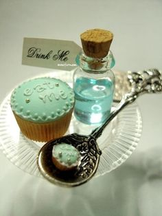 Eat me. Drink me. Shots in a little bottle & Cup Cakes. Brilliant.
