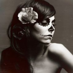 Black and white day of  dead dia de los muertos face flowers girl