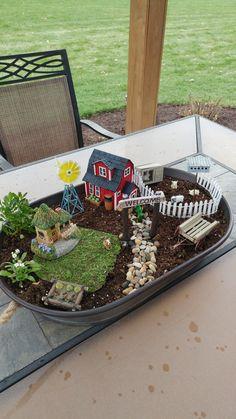 Created by Karen Berg...I wanted a little farm fairy garden but now I need a farmer fairy.