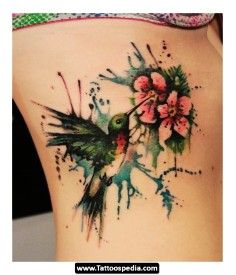 Lily flower watercolor tattoo on side of knee - flower, bud, ink art | DIY Watercolor Tattoo