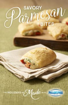 Bite sized apps with big sized flavor, these Savory Parmesan Bites with PHILADELPHIA Cream Cheese, KRAFT Grated Parmesan Cheese, crescent dinner rolls, red pepper, and fresh parsley will keep your guests merry this holiday season.