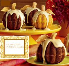 Glazed Mini Pumpkin Cakes with Caramel Rum Glaze - two mini bundt cakes stacked together - using Trader Joe's Pumpkin Bread Mix: Modify the mix: 2 eggs, c. water, 1 whole jar of Trader Joe's Pumpkin Butter. Pumpkin Bread Mix, Pumpkin Bundt Cake, Pumpkin Butter, Pumpkin Shaped Cake, Halloween Desserts, Fall Desserts, Dessert Recipes, Halloween Cupcakes, Halloween Dinner