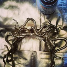 Rubber snakes, jewelry wire, headband and gold spray paint for a medusa costume