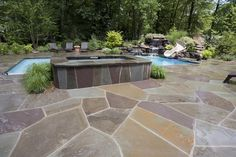 Beautiful stonework enhances this amazing backyard retreat.