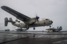 WATERS EAST OF OKINAWA,July 31,2014.Grumman C-2A Greyhound of Providers of Fleet Logistics Support Squadron (VRC) 30 prepares to make arrested landing on flight deck of US Navy's forward-deployed aircraft carrier USS George Washington (CVN 73).George Washington & embarked air wing, Carrier Air Wing (CVW) 5, provide a combat-ready force that protects & defends collective maritime interests of US,allies & partners in Indo-Asia-Pacific region.(USN Mass Comm Spec 3rd Class Paolo Bayas)