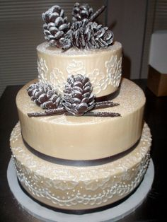 beautiful White Pine Cone Cake dusted with sparkly snow
